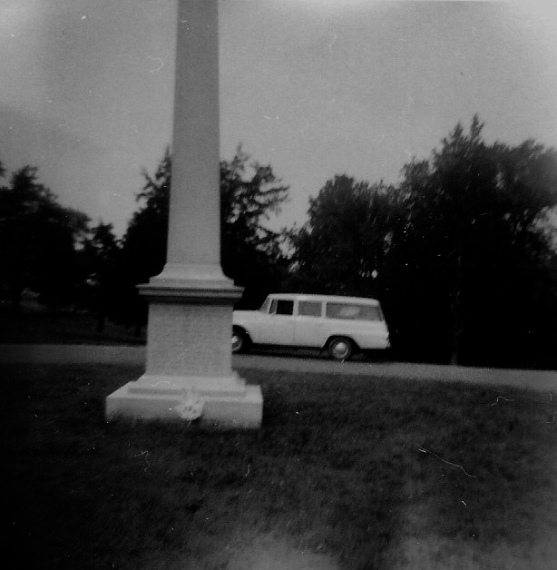 Parked by a monument.